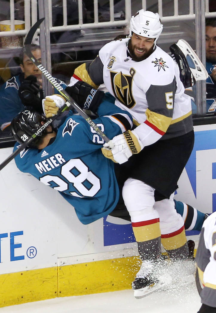 Vegas Golden Knights defenseman Deryk Engelland (5) slams San Jose Sharks right wing Timo Meier (28) during the third period in Game 6 of an NHL hockey second-round playoff series at the SAP Cente ...