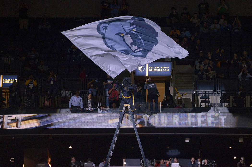 Grizz, mascot for the Memphis Grizzlies, stands on a ladder and waves a flag with the team's logo in the second half of an NBA basketball game against the San Antonio Spurs Friday, Dec. 1, 2017, i ...