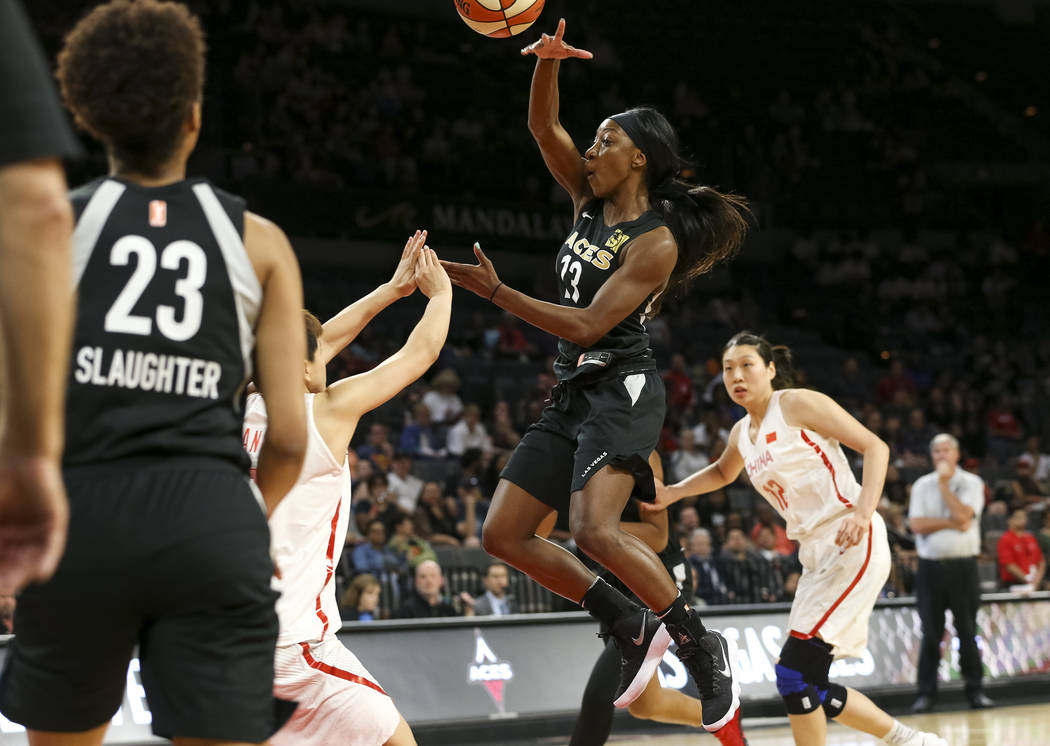 Las Vegas Aces guard Raigyne Louis (13) passes the ball to forward Ivey Slaughter (23) during a preseason basketball game against the Chinese national team at Mandalay Bay Events Center in Las Veg ...