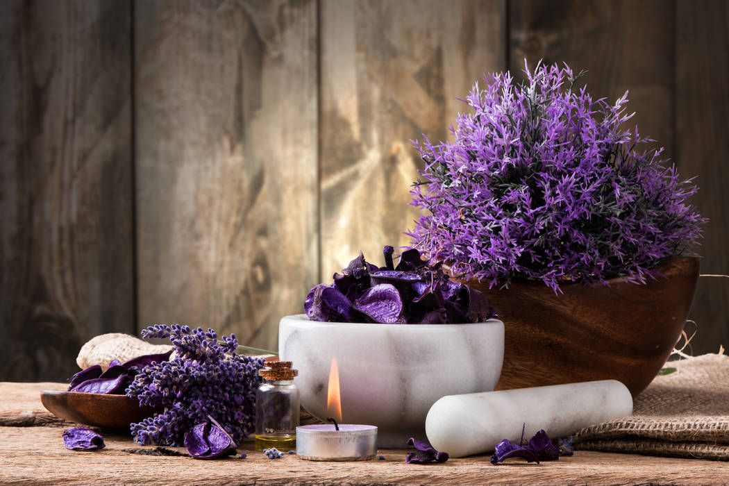 Thinkstock Scents, such as lavender, and low lighting, like candles, complete a meditation space.