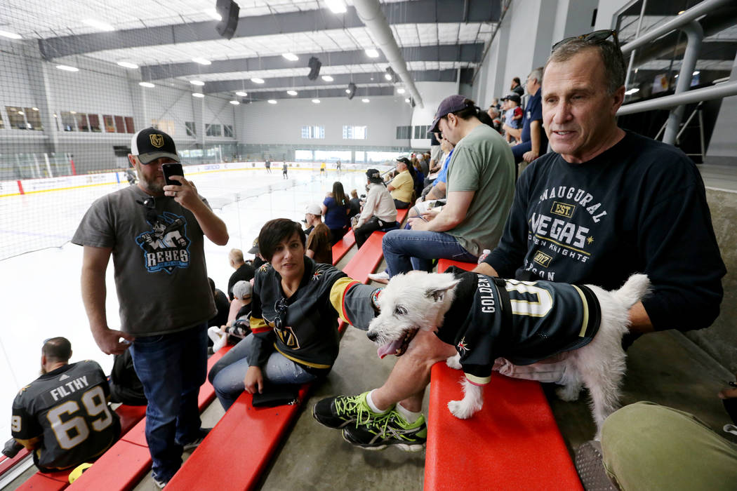 Bark-Andre Furry and his owner, Rick Williams, watch the Vegas Golden Knights practice as Frank Acosta and Darla Schneider watch Bark at City National Arena in Las Vegas on Wednesday, May 9, 2018. ...