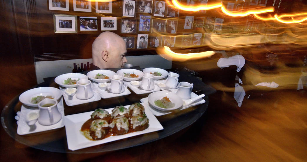 Waiter Davor Vidovic takes food to a table at Rao's during Vegas Uncork'd festivities at Caesars Palace at 3570 S. Las Vegas Blvd. in Las Vegas on Thursday, May 10, 2018. Bill Hughes ...