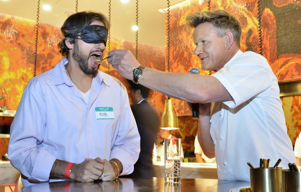 Chef Gordon Ramsay right, feeds Rob Leppke (cq) while conducting a blind taste test during Vegas Uncork'd festivities at Hell's Kitchen at Caesars Palace at 3570 S. Las Vegas Blvd. i ...