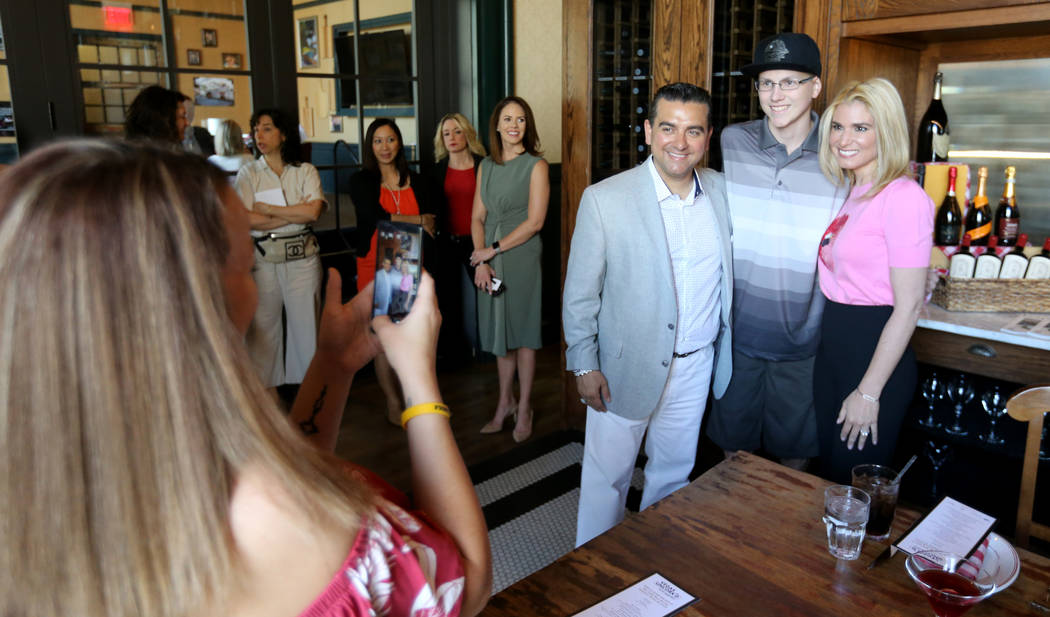Buddy and Lisa Valastro pose with Michael Laliberte, 14, of Canada as Laliberte's mother Erin takes a photo at Buddy V's Ristorante at The Venetian during Vegas Uncork'd Friday, May 11, 2018. K.M. ...