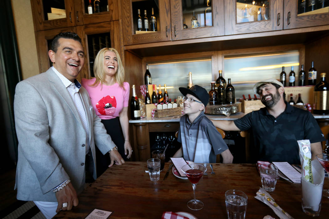 Buddy and Lisa Valastro, left, visit with Michael Laliberte, 14, and his father Dennis Medeiros of Canada at Buddy V's Ristorante at The Venetian during Vegas Uncork'd Friday, May 11, 2018. K.M. C ...