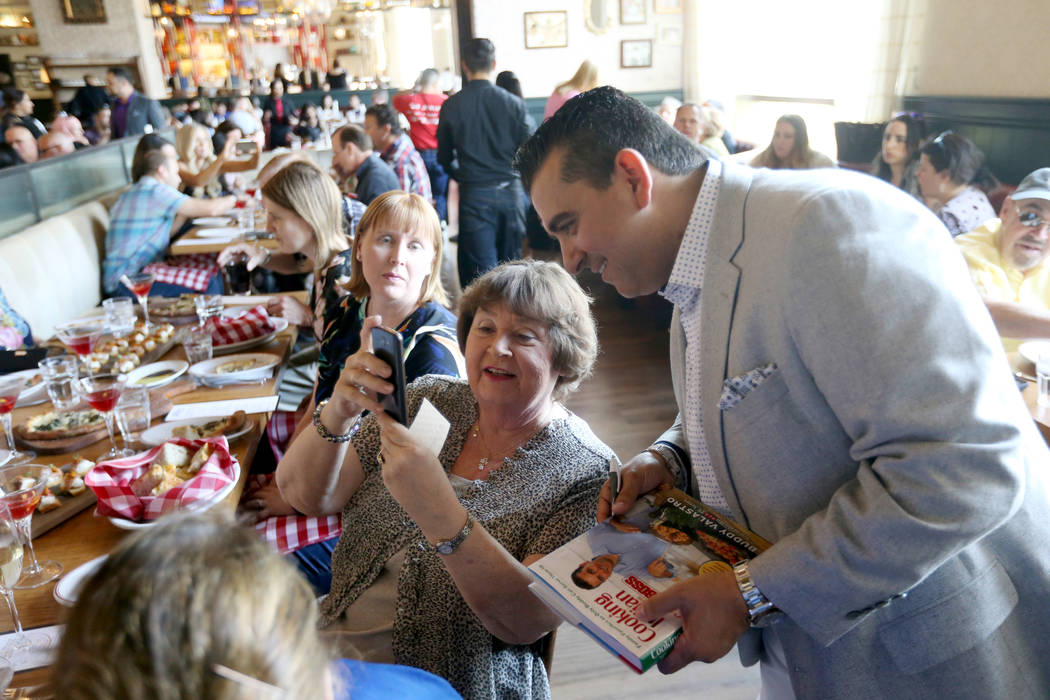 Buddy Valastro visits with Darlene Dycus of Evansville, Ind. at Buddy V's Ristorante at The Venetian during Vegas Uncork'd Friday, May 11, 2018. K.M. Cannon Las Vegas Review-Journal @KMCannonPhoto