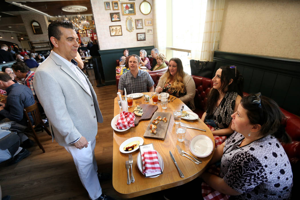 Buddy Valastro visits with, from left, Rob Ernst and Denise Holst of Reno, Peula Fernandez of Argentina and Sandra Martinez of Columbia at Buddy V's Ristorante at The Venetian during Vegas Uncork' ...