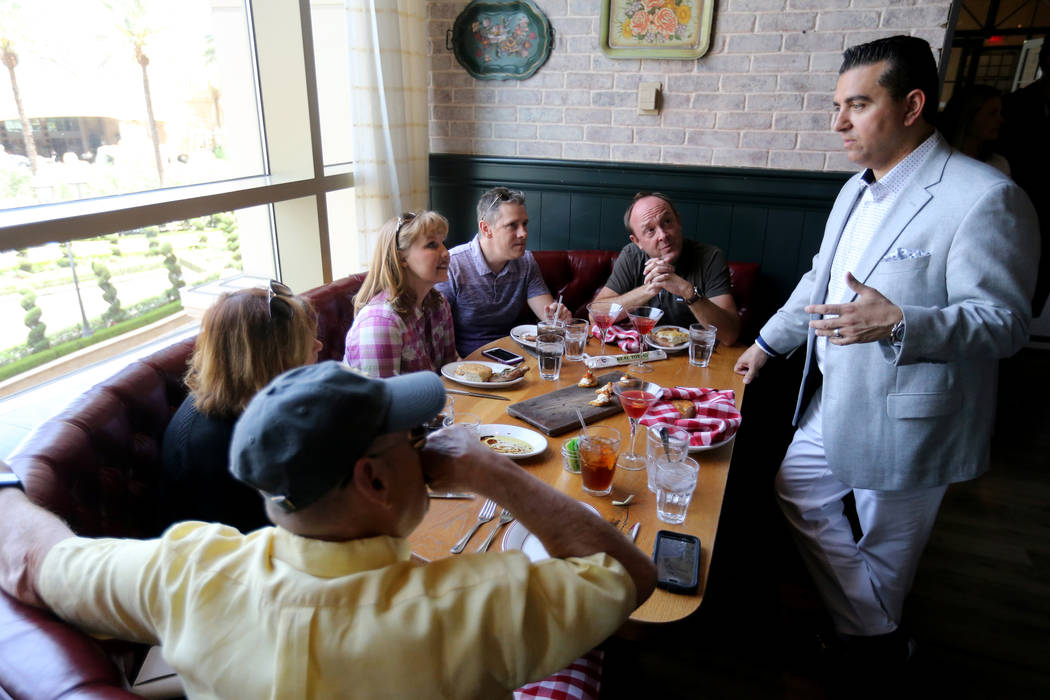 Buddy Valastro visits with, from left, Barbara and Mark Deering of Las Vegas, Traci and Greg Knoyle of Missoula, Mont. and Robert Murinchack of Las Vegas at Buddy V's Ristorante at The Venetian du ...