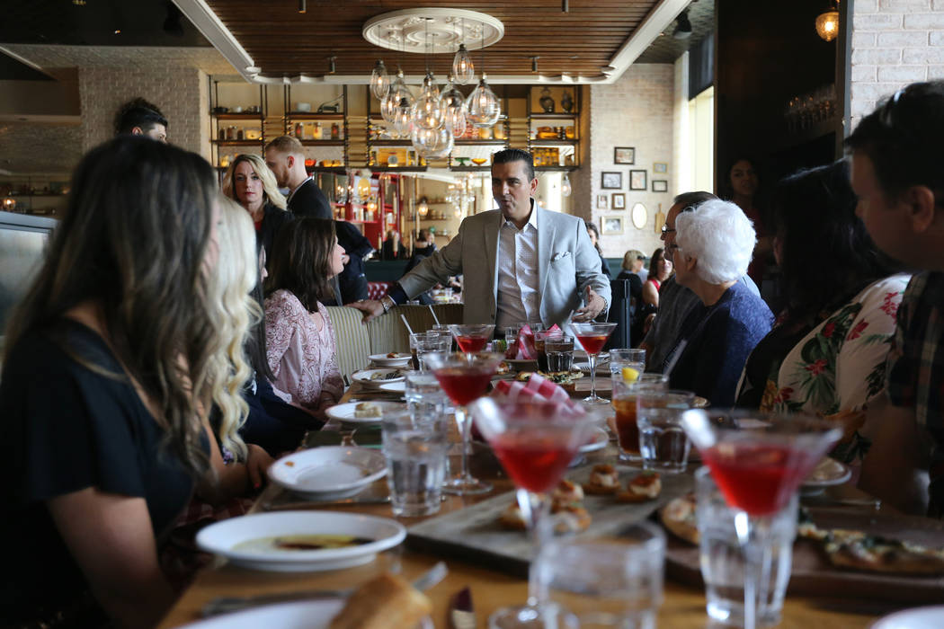Buddy Valastro, center, visits with dinners at Buddy V's Ristorante at The Venetian during Vegas Uncork'd Friday, May 11, 2018. K.M. Cannon Las Vegas Review-Journal @KMCannonPhoto