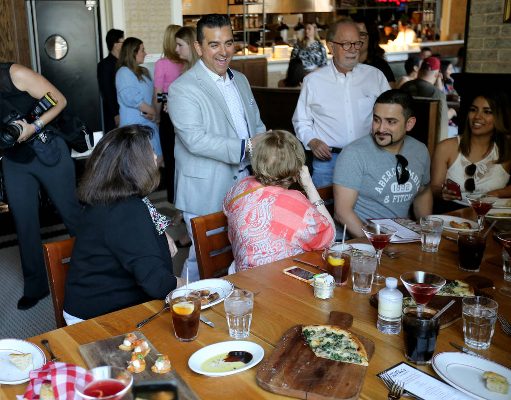 Buddy Valastro, top left,, visits with dinners at Buddy V's Ristorante at The Venetian during Vegas Uncork'd Friday, May 11, 2018. K.M. Cannon Las Vegas Review-Journal @KMCannonPhoto