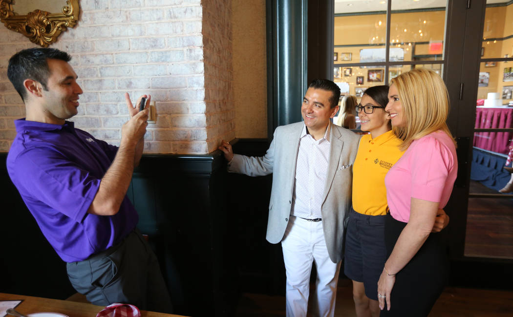 Buddy and Lisa Valastro pose with Nia Rico, 14, as Rico's father Anthony Rico takes a photo at Buddy V's Ristorante at The Venetian during Vegas Uncork'd Friday, May 11, 2018. K.M. Cannon Las Vega ...