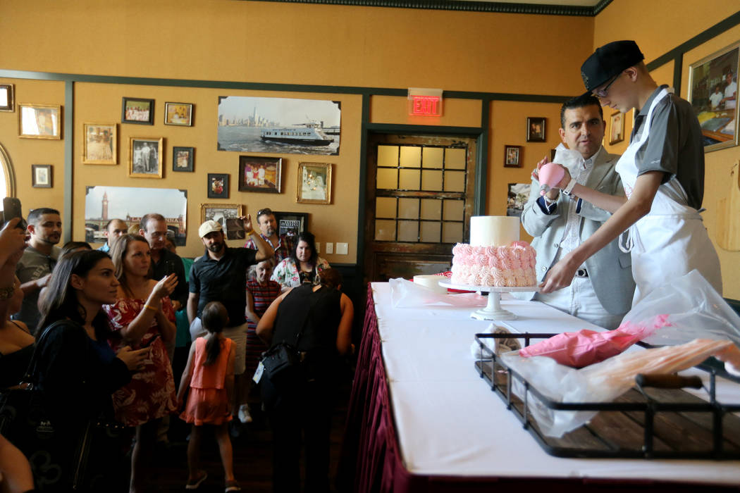 Buddy Valastro, left, decorates a cake with Michael Laliberte, 14, of Canada at Buddy V's Ristorante at The Venetian during Vegas Uncork'd Friday, May 11, 2018. K.M. Cannon Las Vegas Review-Journa ...