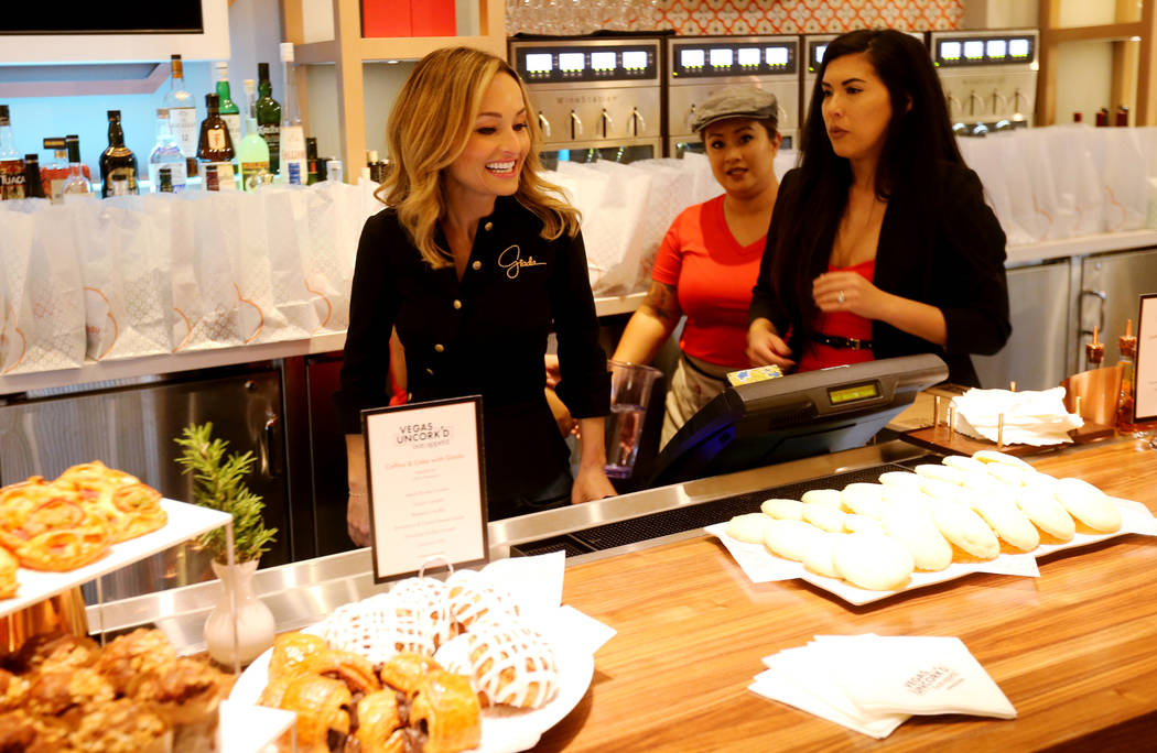 Giada De Laurentiis, left, checks out the spread with General Manager Megan Hutton, right , and Antonia Legaspi at Pronto by Giada at Caesars Palace during Vegas Uncork'd Friday, May 11, 2018. K.M ...