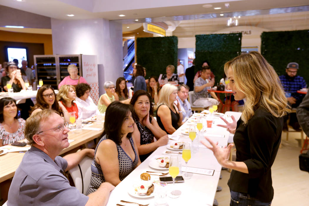 Giada De Laurentiis, right, greets, from left, Rob McCormack, Gina McCormack, Brenda Conners, Traci Sharp and Roger Sharp, all of Bakersfield, Calif., at Pronto by Giada at Caesars Palace during V ...