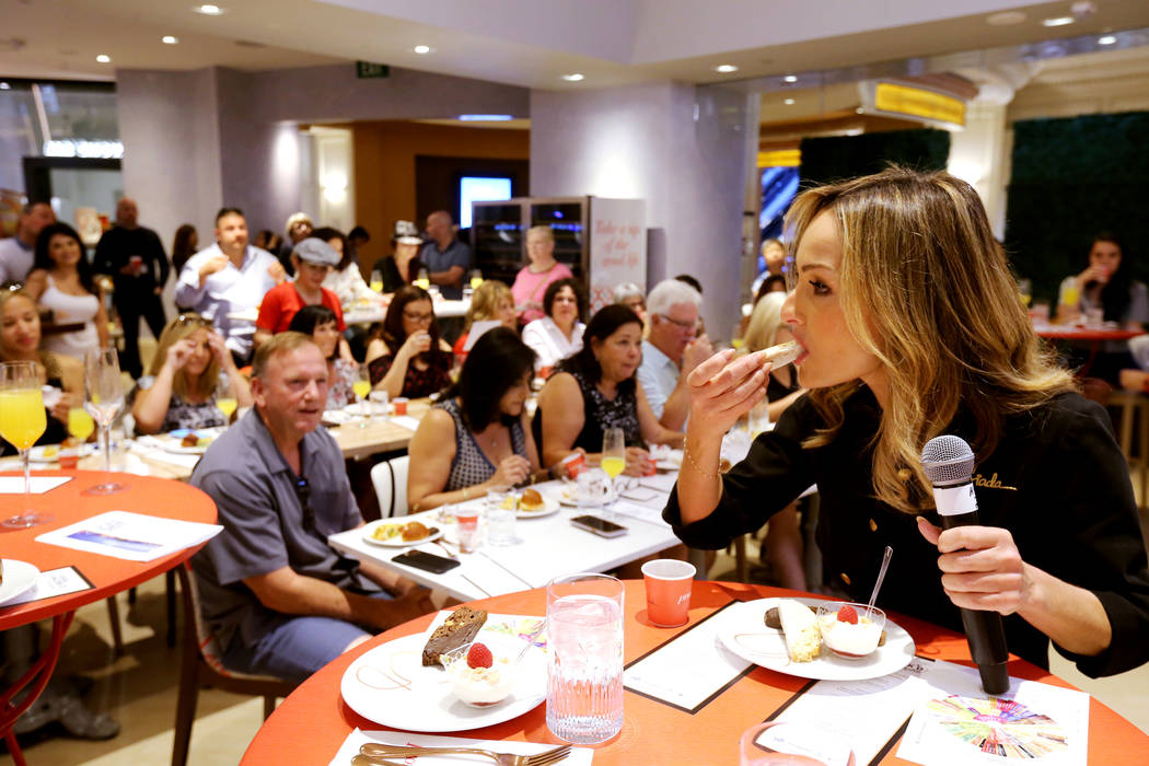 Giada De Laurentiis, right, tries a biscotto dipped in coffee at Pronto by Giada at Caesars Palace during Vegas Uncork'd Friday, May 11, 2018. K.M. Cannon Las Vegas Review-Journal @KMCannonPhoto