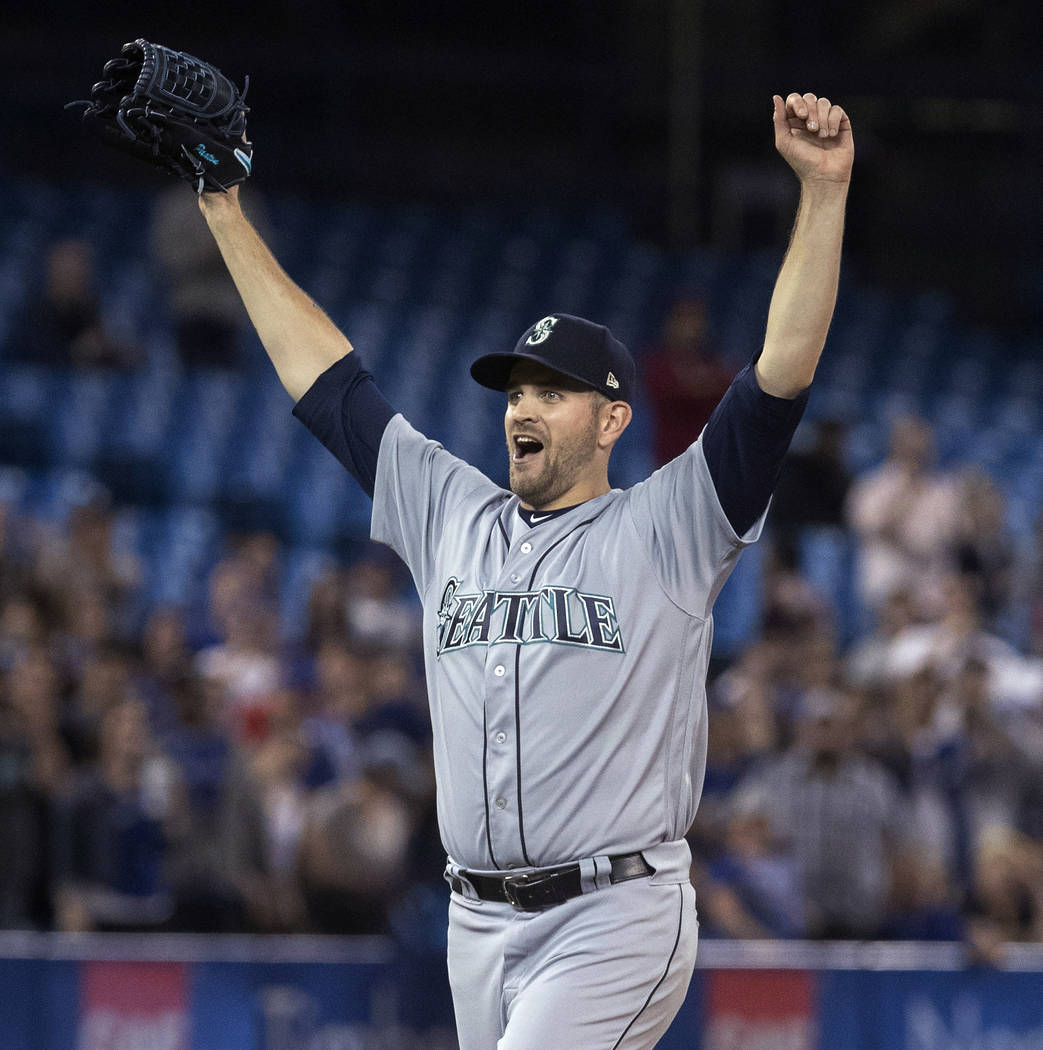 Seattle Mariners starting pitcher James Paxton celebrates after throwing a no-hitter against the Toronto Blue Jays in a baseball game Tuesday, May 8, 2018, in Toronto. (Fred Thornhill/The Canadian ...