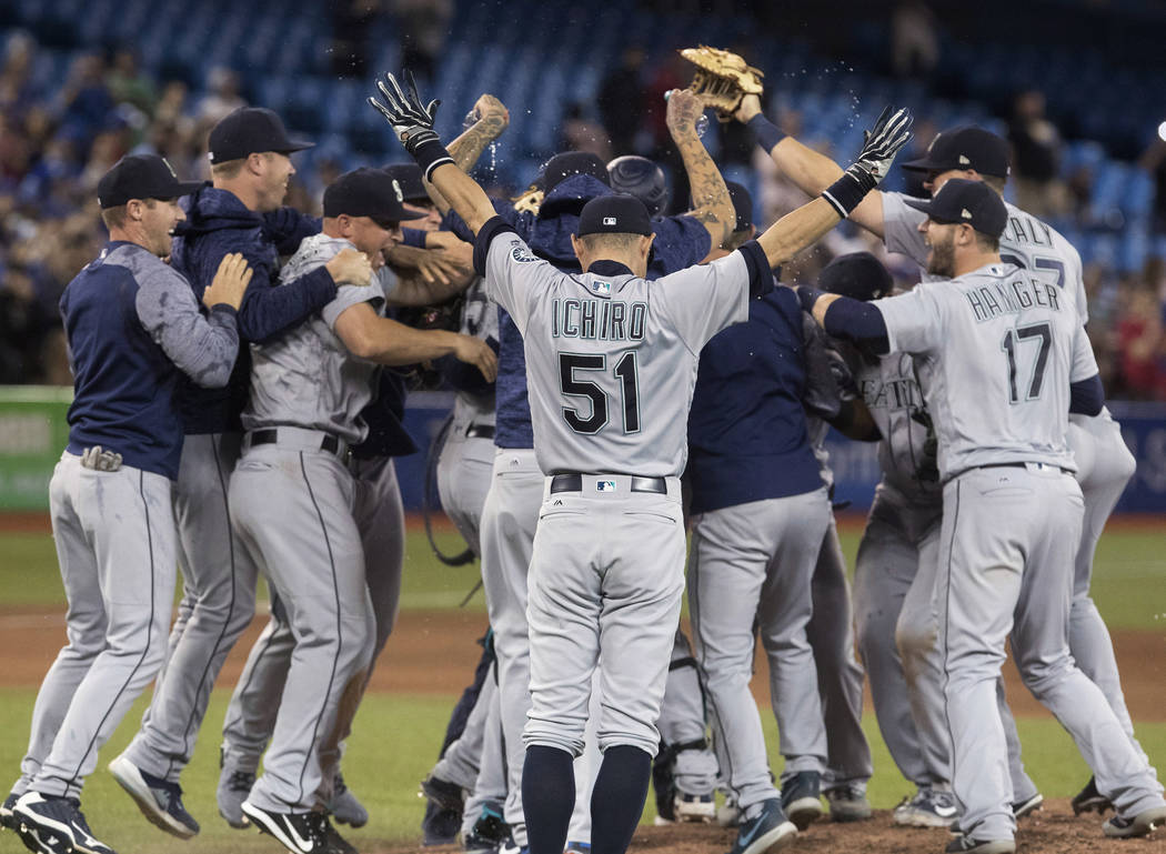 Seattle Mariners starting pitcher James Paxton is mobbed by teammates after throwing a no-hitter against the Toronto Blue Jays in a a baseball game Tuesday, May 8, 2018, in Toronto. (Fred Thornhil ...