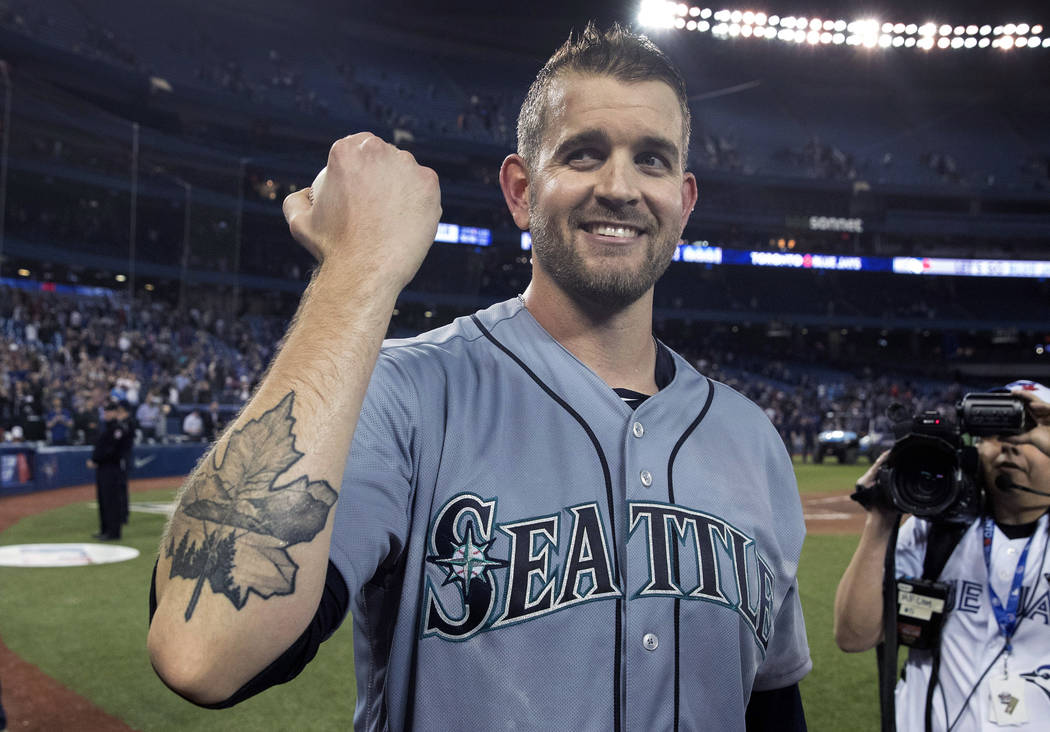 Seattle Mariners starting pitcher James Paxton shows off his Maple Leaf tattoo after pitching a no-hitter against the Toronto Blue Jays in a baseball game Tuesday, May 8, 2018, in Toronto. (Fred T ...