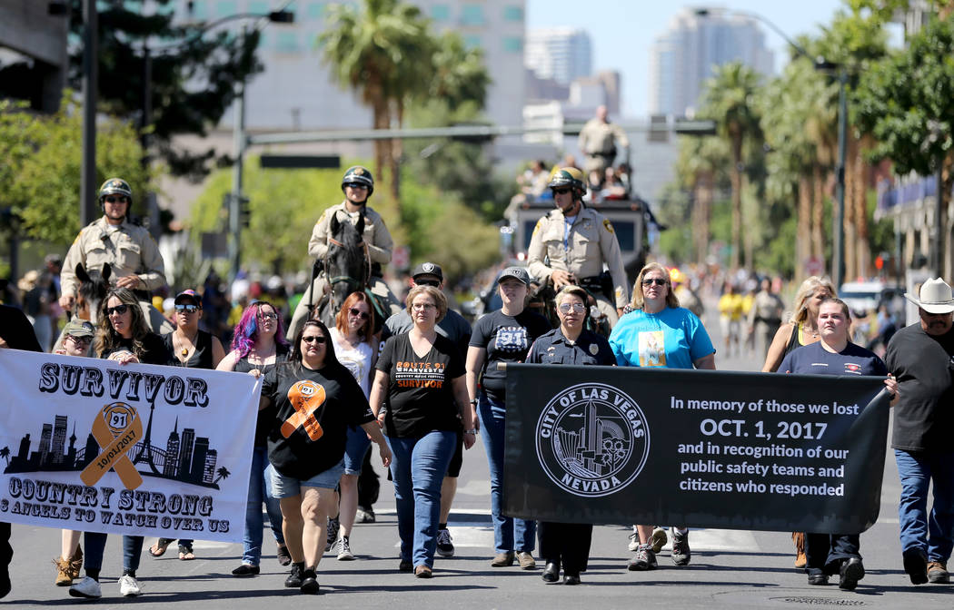 Members of the One October entry, made up of first responders and survivors of the Oct. 1 shooting on the Strip, march in the Helldorado Days parade in downtown Las Vegas Saturday, May 12, 2018. K ...