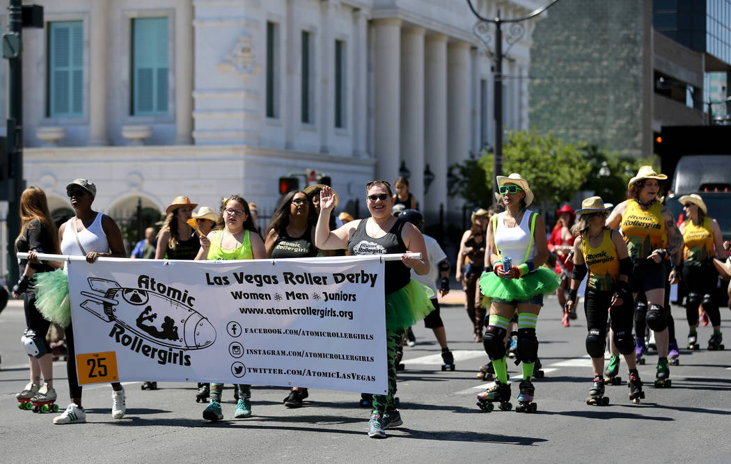 Members of the Atomic Rollergirls Las Vegas Roller Derby roll in the Helldorado Days parade in downtown Las Vegas Saturday, May 12, 2018. K.M. Cannon Las Vegas Review-Journal @KMCannonPhoto