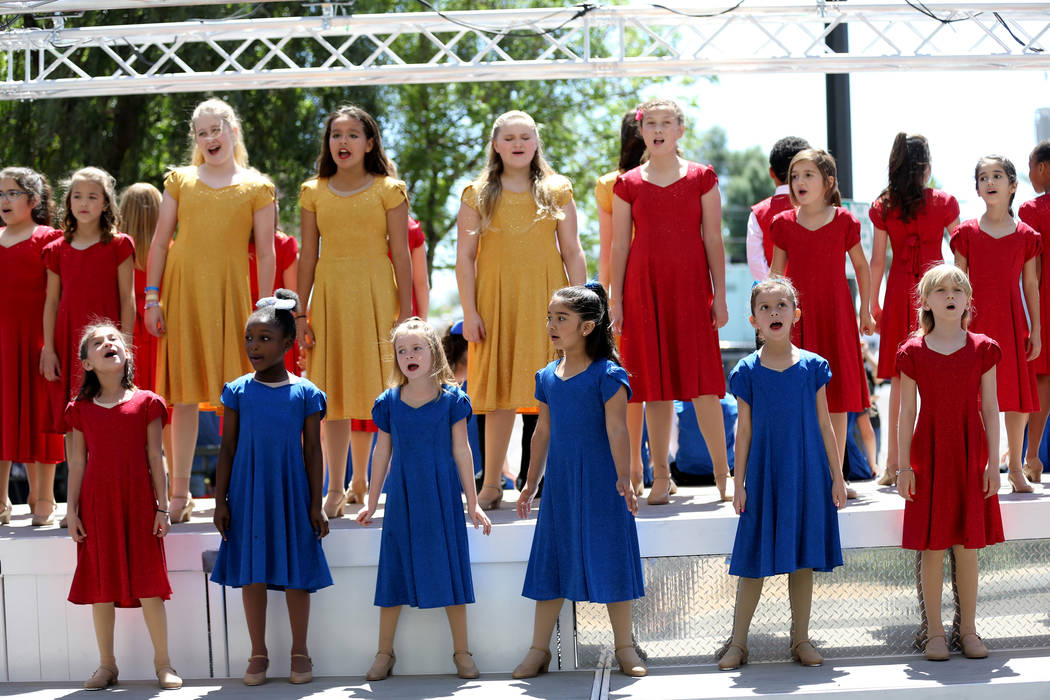 Members of the Broadway Kids Academy Performance Company sing in the Helldorado Days parade in downtown Las Vegas Saturday, May 12, 2018. K.M. Cannon Las Vegas Review-Journal @KMCannonPhoto