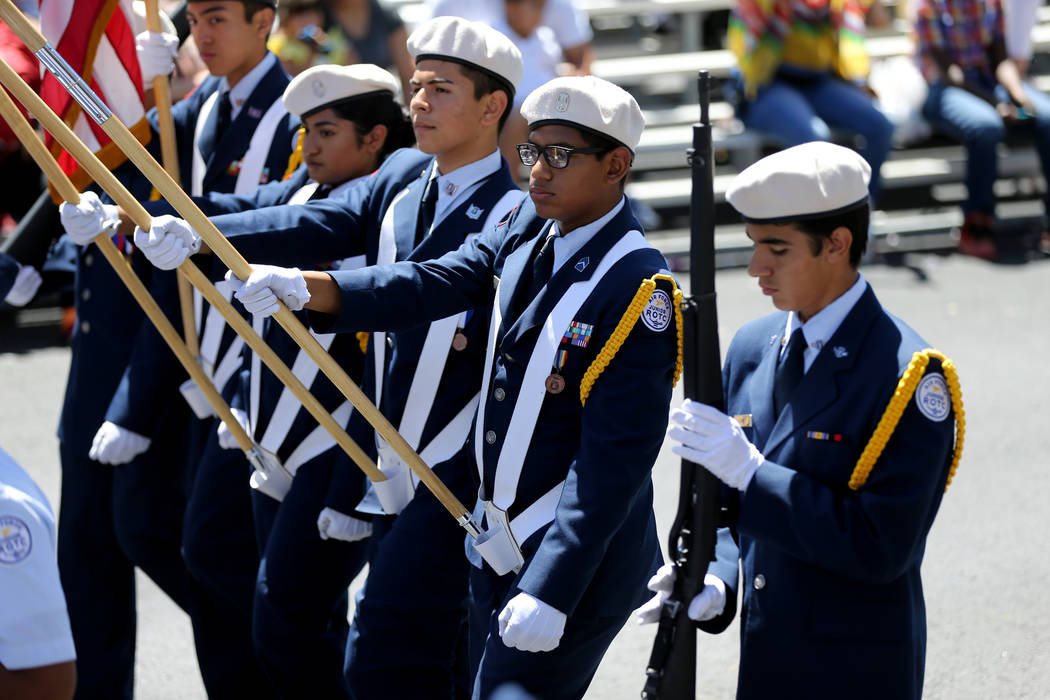 Members of the Cimarron Memorial High School Air Force junior ROTC march in the Helldorado Days parade in downtown Las Vegas Saturday, May 12, 2018. K.M. Cannon Las Vegas Review-Journal @KMCannonPhoto