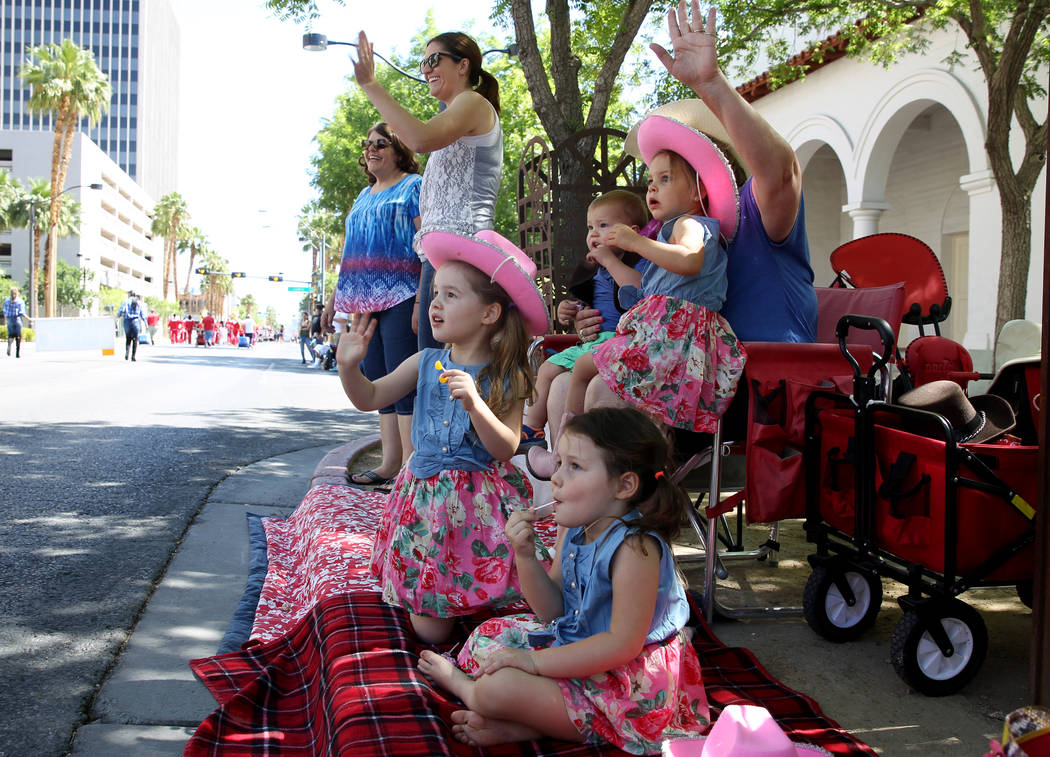 Las Vegas cousins, from left, Alexandra Hayes, 4, Sydney Hayes, 4, Luke Nelson, 15 months, and Grace Nelson, 2, watch the Helldorado Days parade in downtown Las Vegas Saturday, May 12, 2018. K.M. ...
