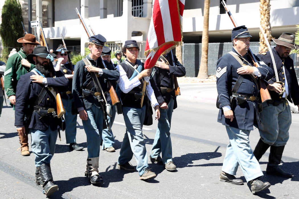 Members of the Southern Nevada Living History Association march in the Helldorado Days parade in downtown Las Vegas Saturday, May 12, 2018. K.M. Cannon Las Vegas Review-Journal @KMCannonPhoto