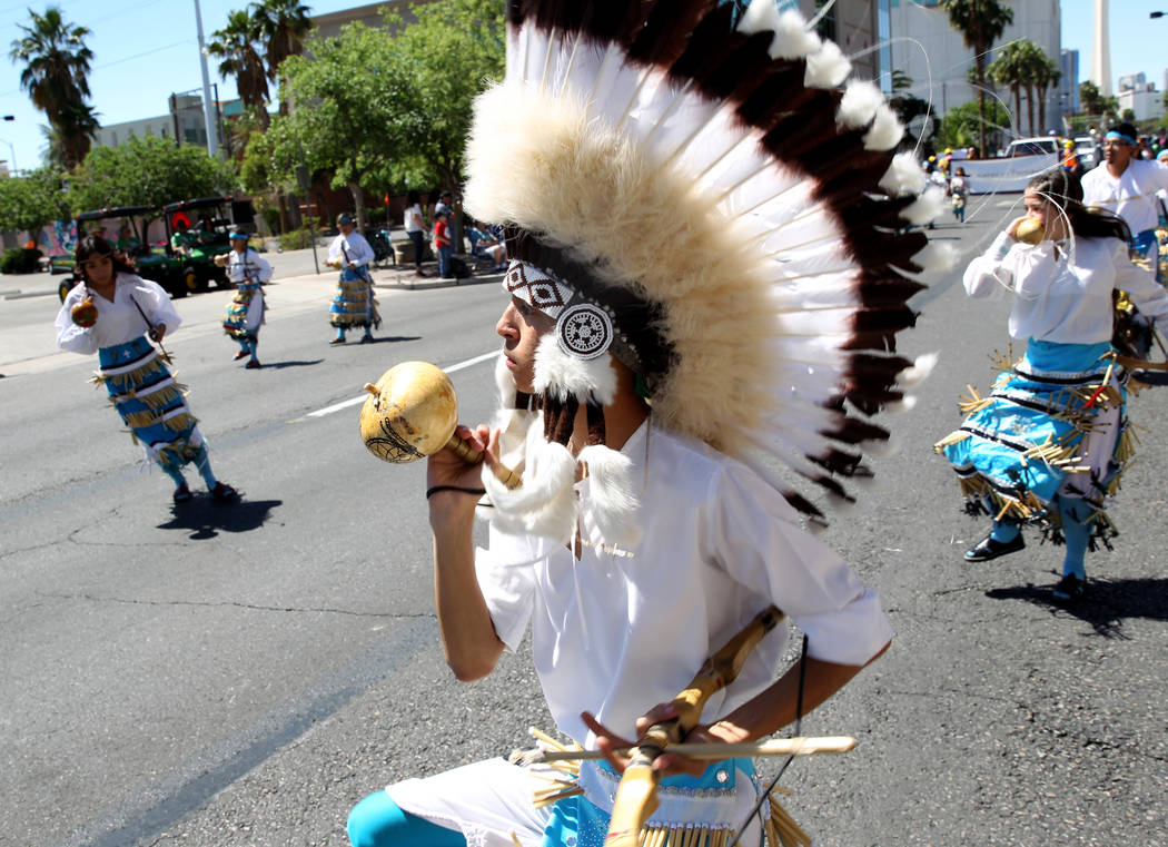 Emiliano Martinez, 16, and fellow members of Danza Del Carrizo dance in the Helldorado Days parade in downtown Las Vegas Saturday, May 12, 2018. K.M. Cannon Las Vegas Review-Journal @KMCannonPhoto