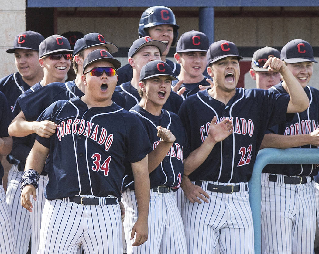 Coronado players celebrate after first baseman Boston Mabeus (23) scores in the first inning against Liberty High School during the opening round of the Sunrise Region baseball tournament on Tuesd ...