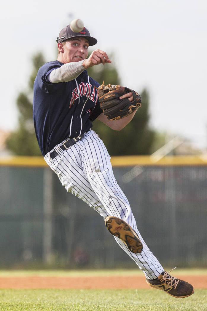 Coronado second baseman Taylor Darden (2) makes a leaping throw in the third inning during the Cougars road matchup with Liberty High School during the opening round of the Sunrise Region baseball ...