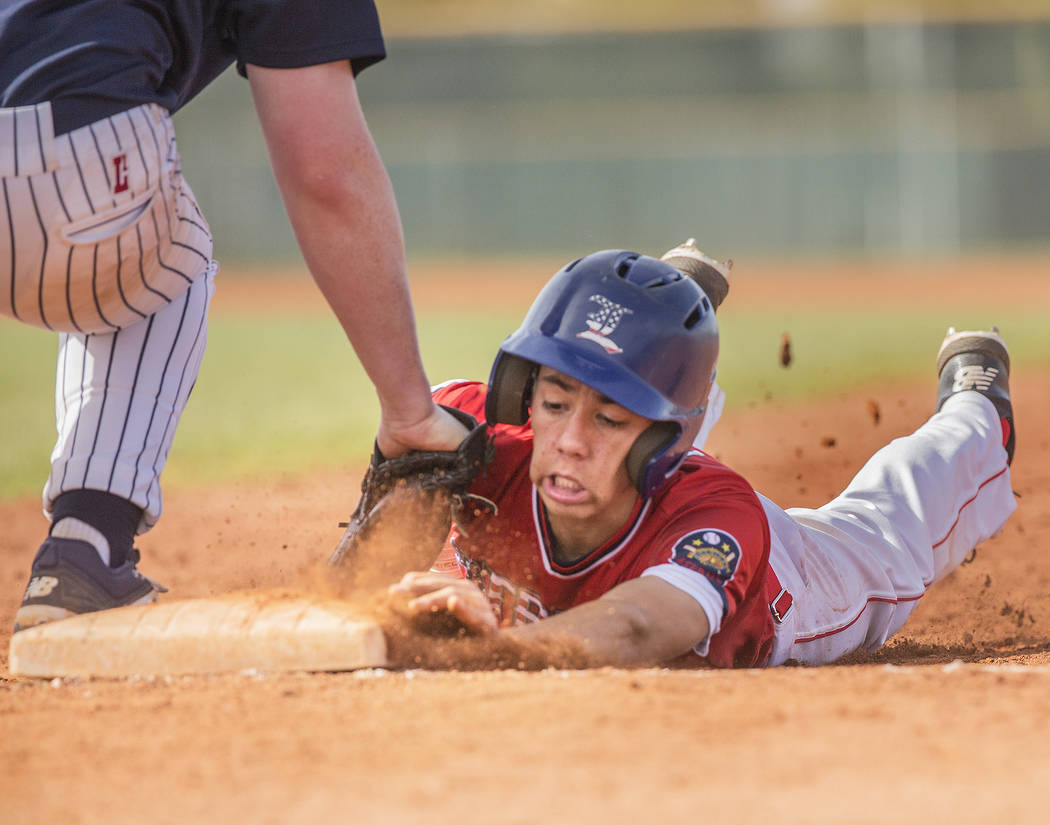Liberty's Jack Hale (20) is picked off at first base by Coronado's Boston Mabeus (23) during the Patriots home matchup with the Cougars during the opening round of the Sunrise Region baseball tour ...