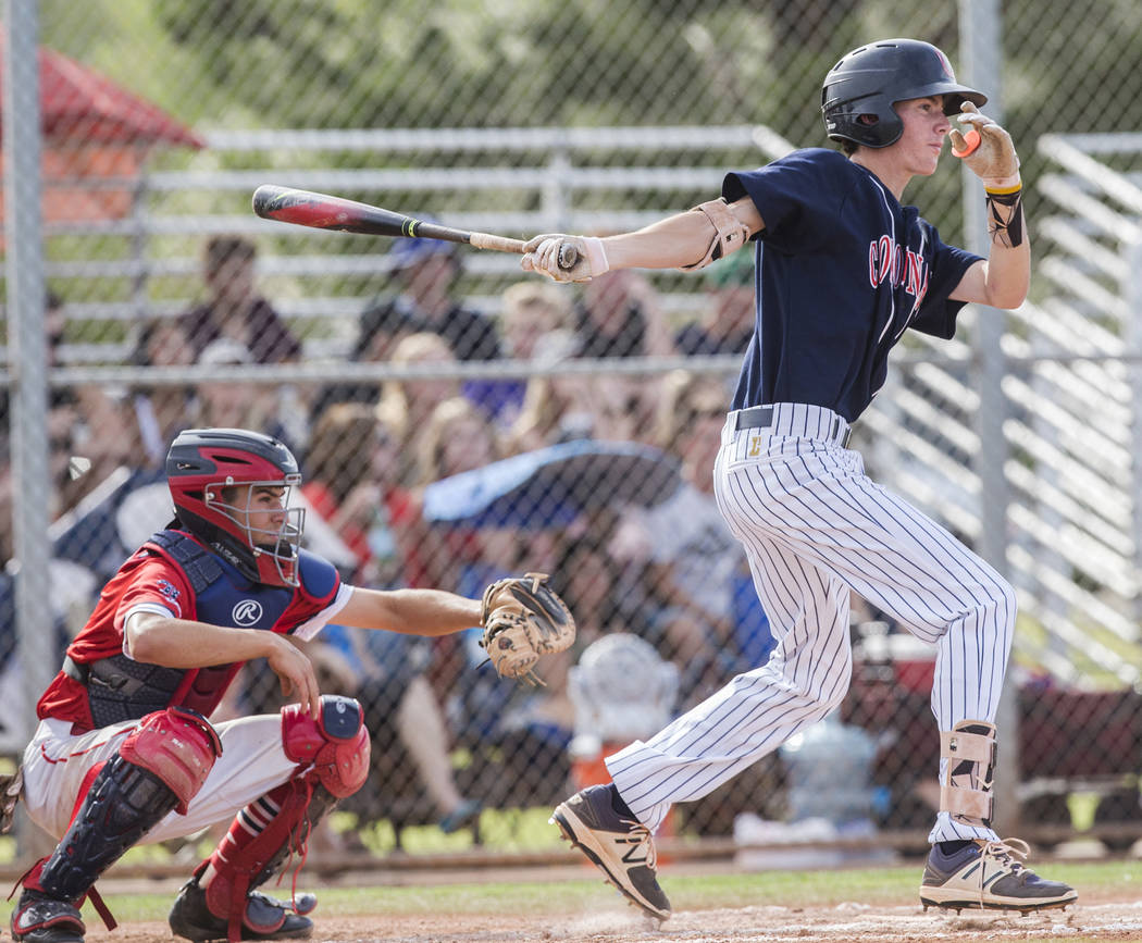 Coronado's Ethan Stephens (24) singles in a run in the second inning during the Cougars road matchup with Liberty High School during the opening round of the Sunrise Region baseball tournament on ...