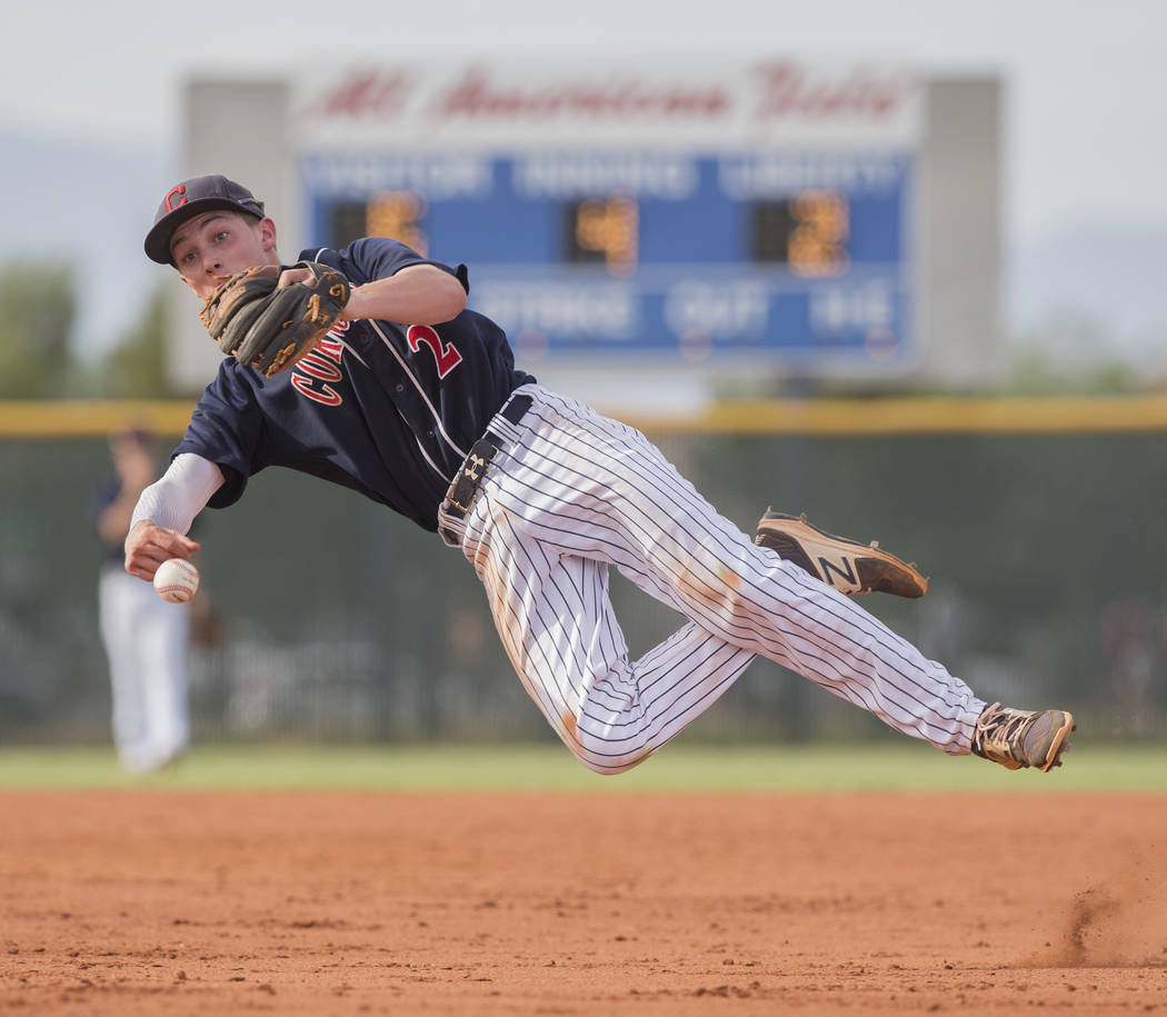 Coronado second baseman Taylor Darden (2) makes a leaping throw in the fourth inning during the Cougars road matchup with Liberty High School during the opening round of the Sunrise Region basebal ...