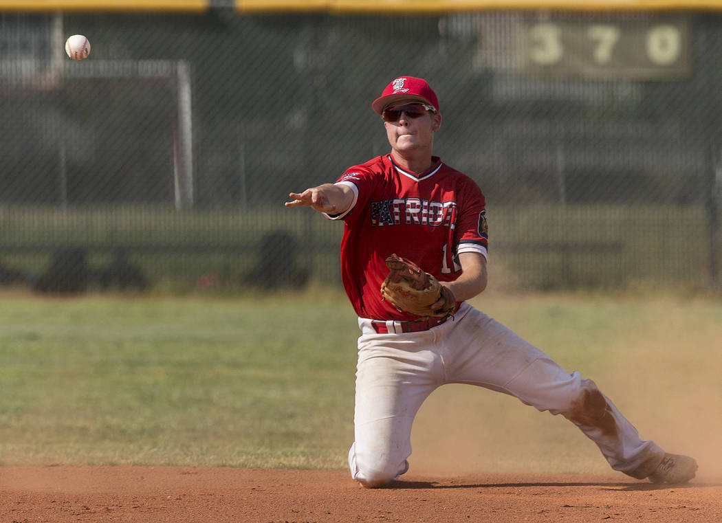 Liberty second baseman Tyler Williamson (12) makes a sliding stop in the first inning during the Patriots home matchup with Coronado High School during the opening round of the Sunrise Region base ...
