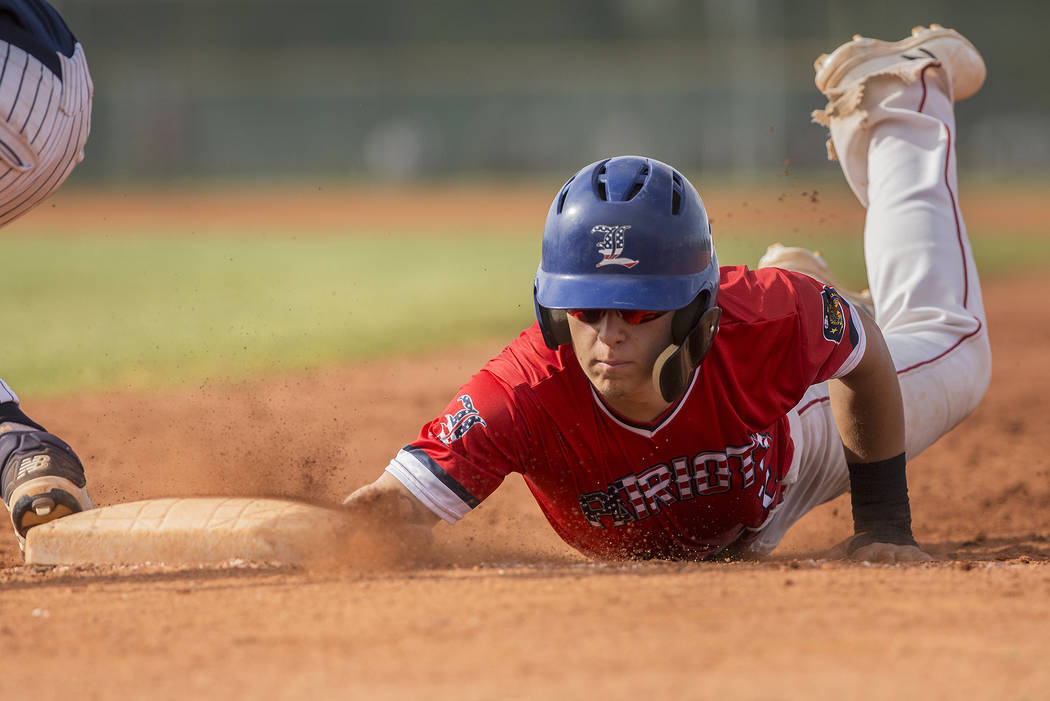 Liberty's Joseph Rush (2) slides in safely past Coronado's Boston Mabeus (23) in third inning during the Patriots home matchup with the Cougars during the opening round of the Sunrise Region baseb ...
