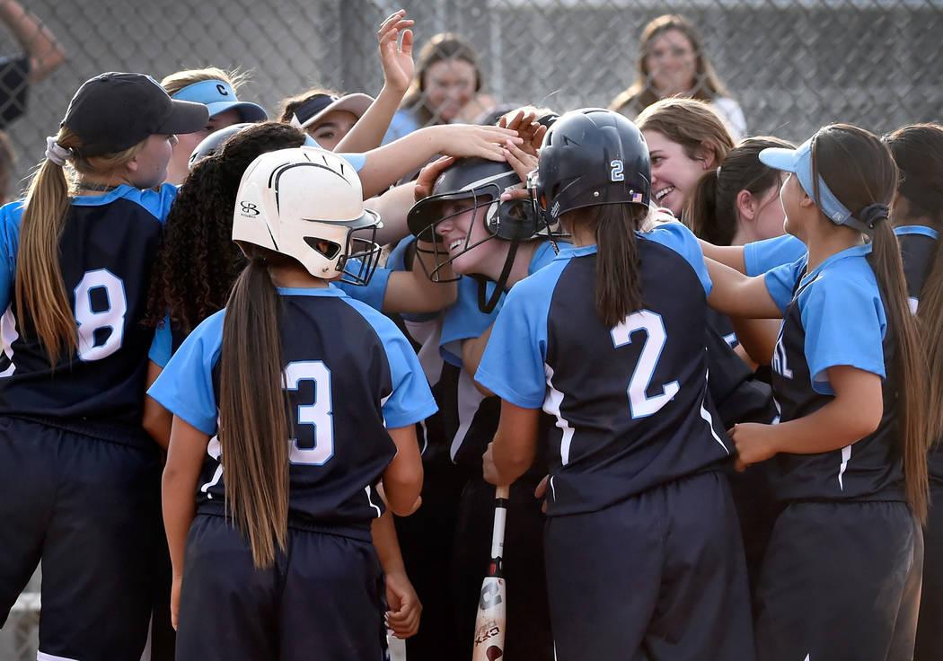 The Centennial bench celebrates Jillian Bartley's, center, two-run home run against Durango during a high school softball game at Durango High School Tuesday, May 8, 2018, in Las Vegas. Centennial ...