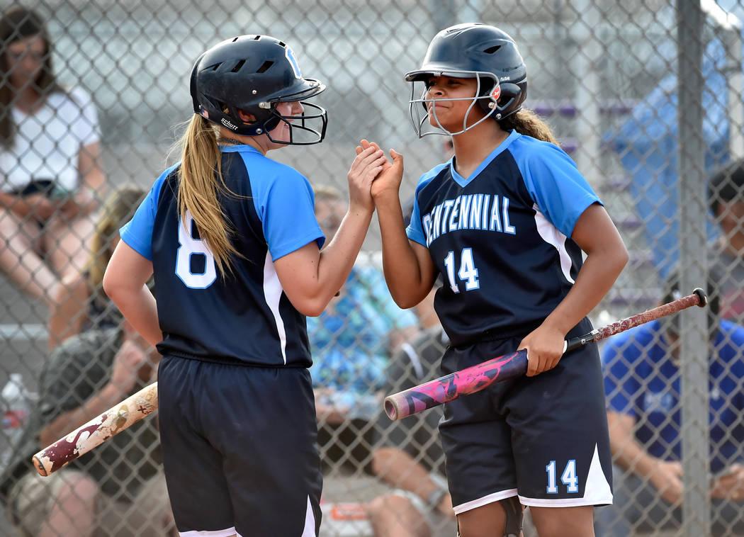 Centennial's Ashlynn Heck (8) and Maddie Kallfelz celebrate a run against Durango during a high school softball game at Durango High School Tuesday, May 8, 2018, in Las Vegas. Centennial won 12-0. ...