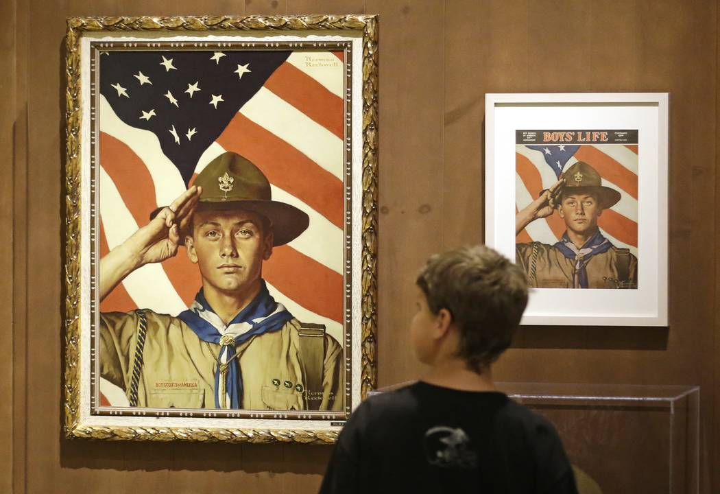 In this July 22, 2013, file photo, Andrew Garrison, 11, of Salt Lake City, looks over the Rockwell exhibition at the Mormon Church History Museum in Salt Lake City, Utah. Twenty-three original, Bo ...