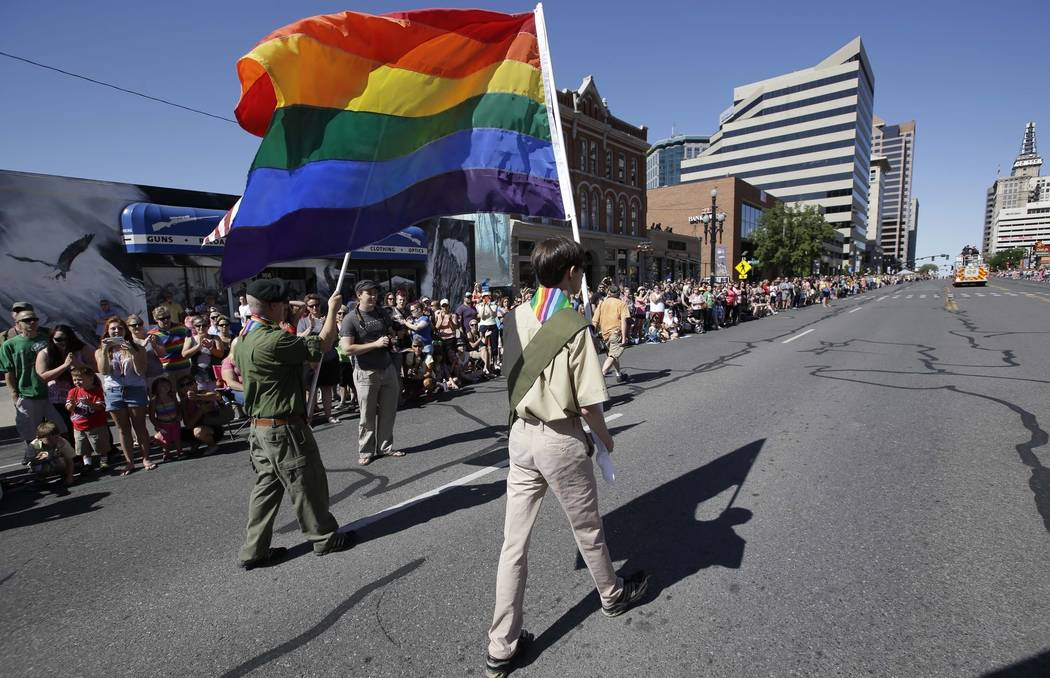 In this June 8, 2014, file photo, a group of Boy Scouts march during the Salt Lake City's annual gay pride parade in Salt Lake City. An announcement Tuesday night, May 8, 2018, by The Church of Je ...