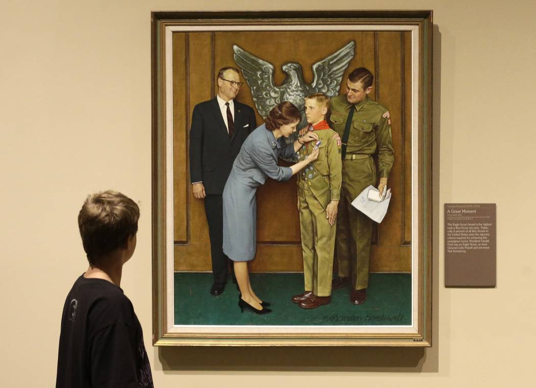 In this July 22, 2013, file photo, Andrew Garrison, 11, of Salt Lake City, looks over the Rockwell exhibition at the Mormon Church History Museum, in Salt Lake City, Utah. Twenty-three original, B ...