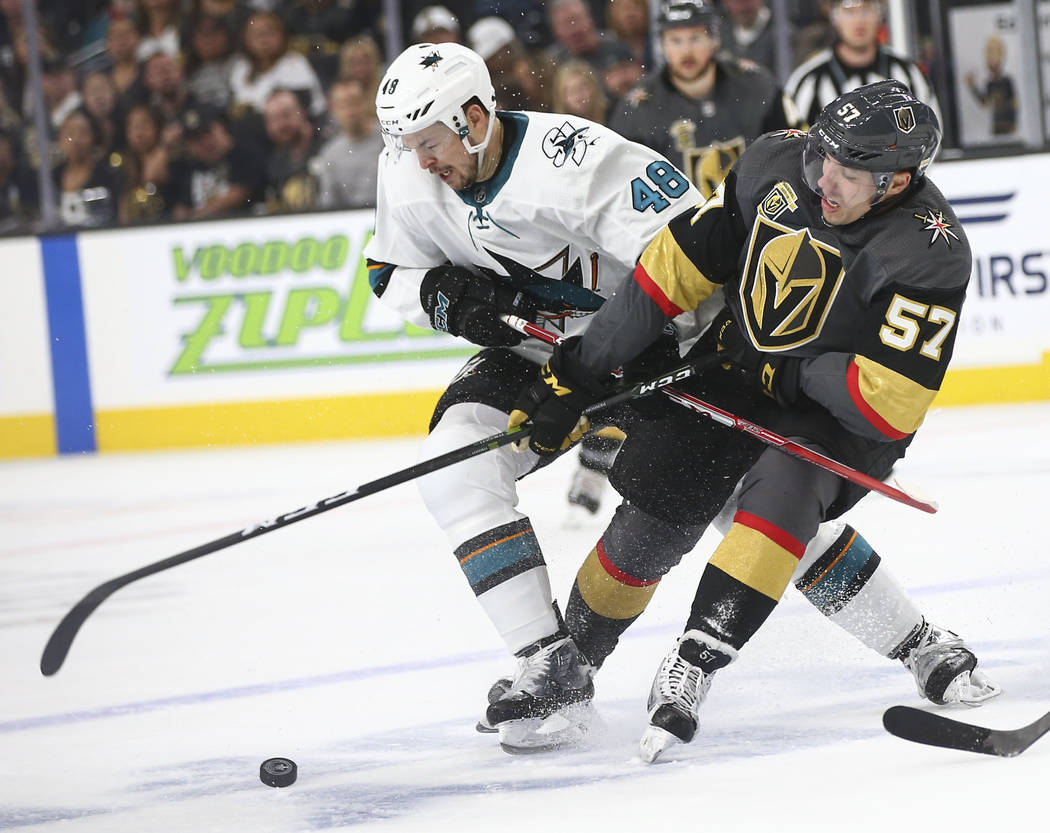 Golden Knights left wing David Perron (57) and San Jose Sharks center Tomas Hertl (48) battle for the puck during the first period of Game 2 of an NHL hockey second-round playoff series at T-Mobil ...