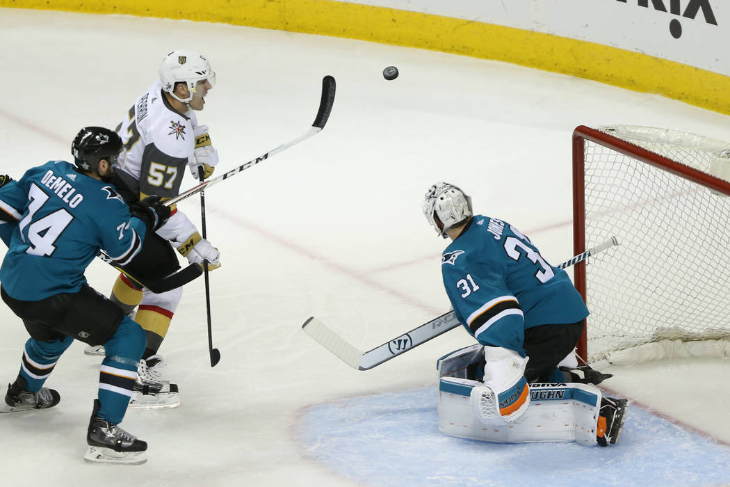 Vegas Golden Knights left wing David Perron (57) looks to make a play against San Jose Sharks defenseman Justin Braun (61), defenseman Dylan DeMelo (74) and goaltender Martin Jones (31) during the ...