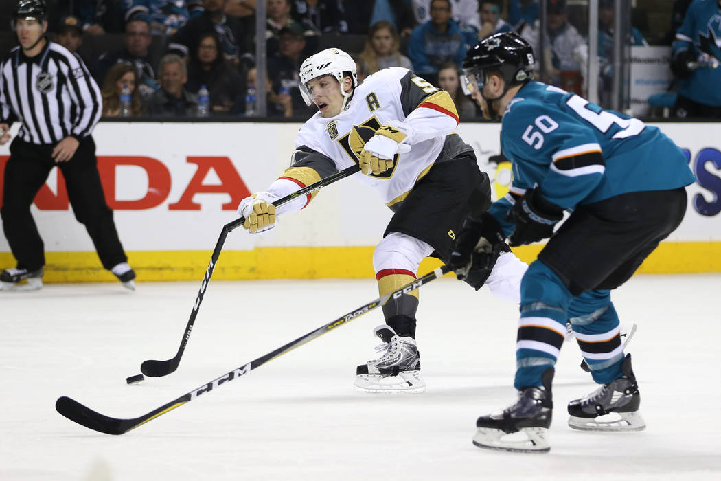 Vegas Golden Knights left wing David Perron (57) takes a shot against San Jose Sharks center Chris Tierney (50) during the third period in Game 4 of an NHL hockey second-round playoff series at th ...
