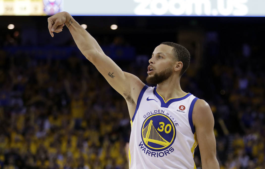 Golden State Warriors' Stephen Curry (30) follows through as he makes a 3-point basket during the second half in Game 5 of an NBA basketball second-round playoff series against the New Orleans Pel ...