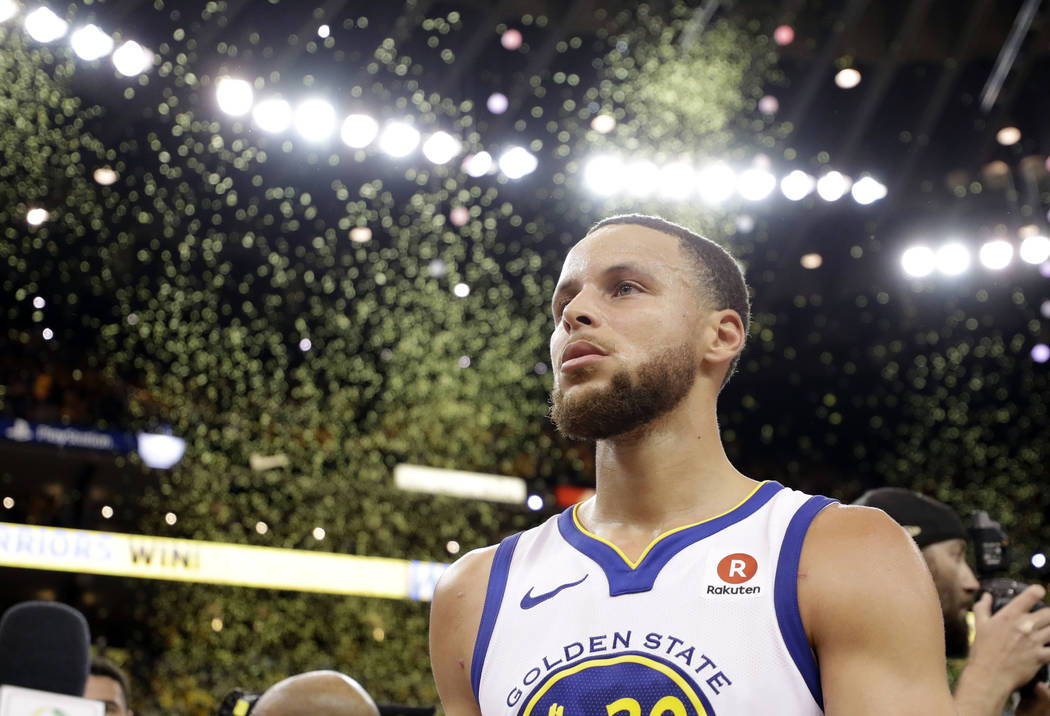 Confetti falls as Golden State Warriors' Stephen Curry walks off the court at the end of Game 5 of the team's NBA basketball second-round playoff series against the New Orleans Pelicans on Tuesday ...