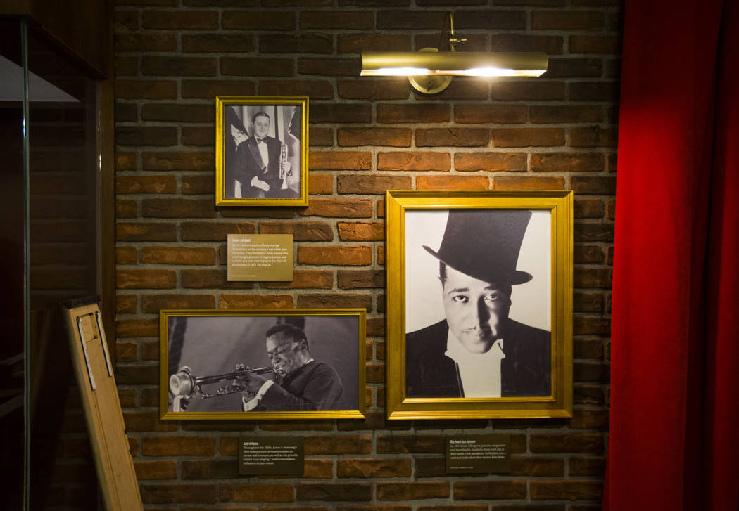 Historic photos of musicians, clockwise from right, Duke Ellington, Louis Armstrong and Bix Beiderbecke are displayed as final touches are made at The Underground at The Mob Museum in downtown Las ...