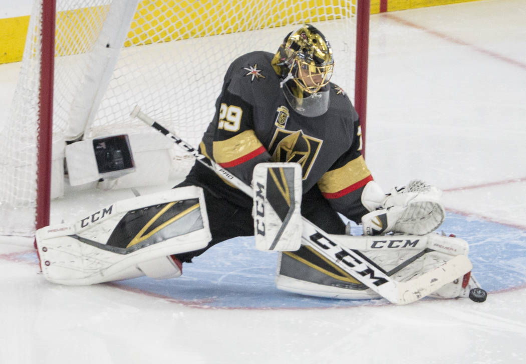Golden Knights goaltender Marc-Andre Fleury (29) makes a save in overtime during game two of their second round playoff series on Saturday, April 28, 2018, at T-Mobile Arena, in Las Vegas. Benjami ...