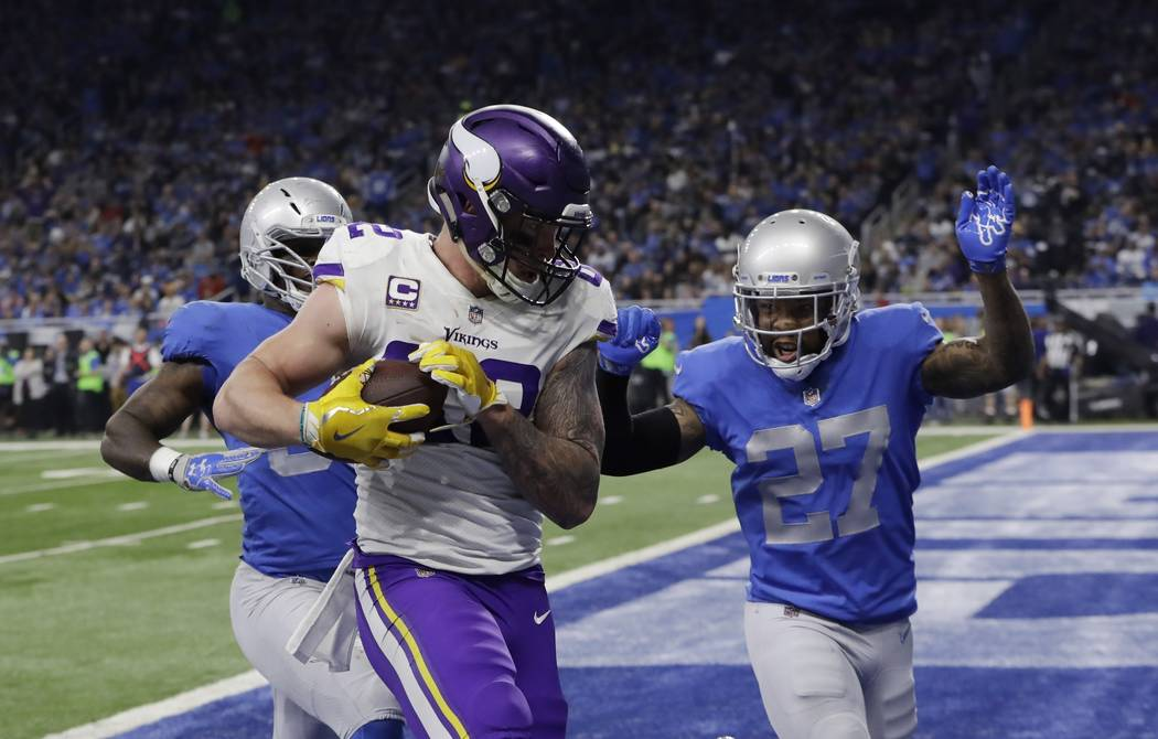 Minnesota Vikings tight end Kyle Rudolph (82) runs into the end zone for a touchdown during the first half of an NFL football game against the Detroit Lions, Thursday, Nov. 23, 2017, in Detroit. ( ...