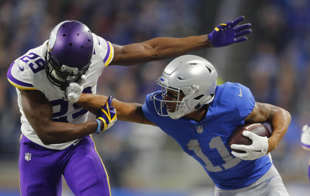 Detroit Lions wide receiver Marvin Jones (11) stiff arms Minnesota Vikings cornerback Xavier Rhodes (29) during an NFL football game in Detroit, Thursday, Nov. 23, 2017. (AP Photo/Paul Sancya)